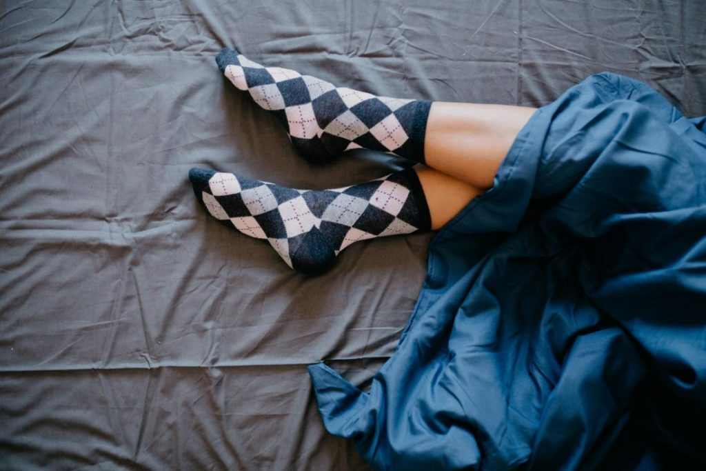 It may seem like wearing socks in bed would overheat the feet. But, in reality, this habit might assist the body's internal temperature regulation.